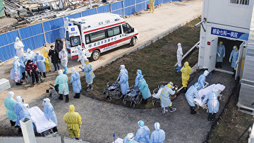 Health workers in protective suits at the field hospital in Wuhan, China